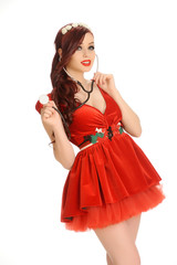 Beautiful woman in a red dress with stethoscope
