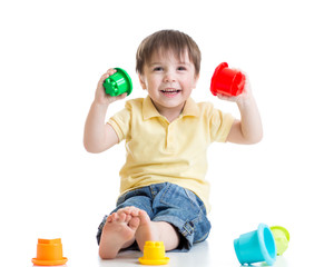 smiling child boy playing with color toys