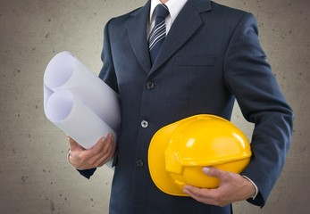 Technician. Man architect wearing suit holding blueprint and