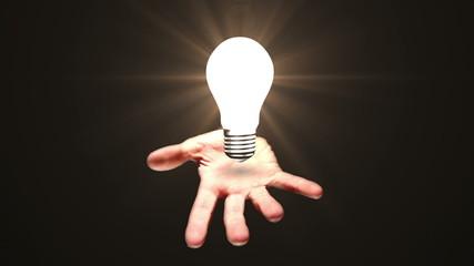 Hand presenting light bulb