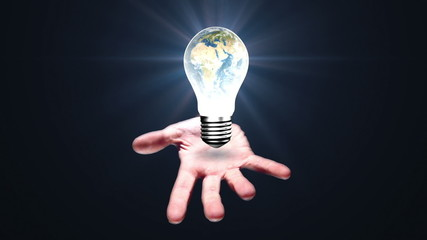 Hand presenting light bulb with earth