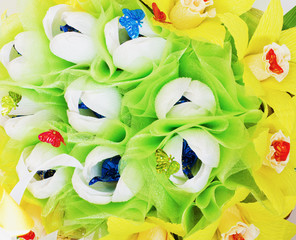 Background from  artificial flowers and sweets