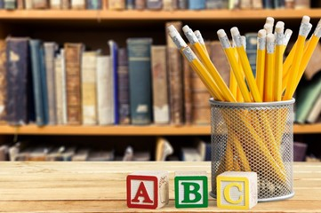 Abc. Yellow pencils and abc blocks for back to school