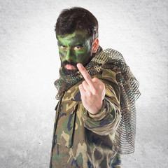 Soldier making horn gesture