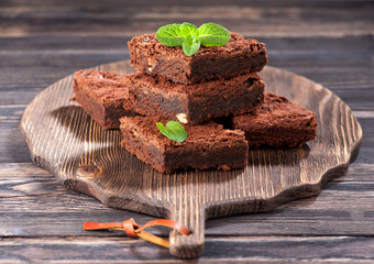Chocolate cake brownies on a wooden background
