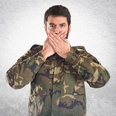 Soldier covering his mouth