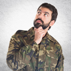 Soldier thinking over white background