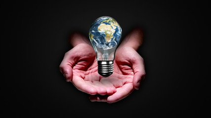 Hands presenting light bulb with earth