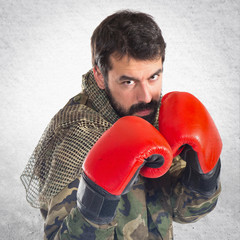 Soldier with boxing gloves