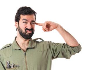 Mechanic making crazy gesture