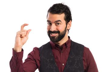 Man wearing waistcoat doing tiny sign