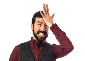 Man wearing waistcoat having doubts