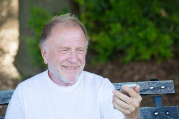 Happy older guy texting