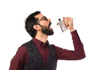 Man wearing waistcoat  holding a coffee pot