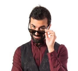 Man wearing waistcoat with sunglasses