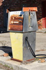 Abandoned gas pump in front of a gas station