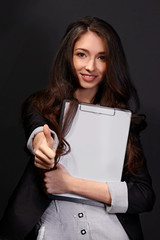 Portrait of  business woman with paper folder