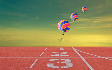 running track number standard red color with three balloons unde