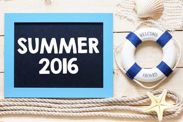 Summer 2016 Text written on blackboard with starfish