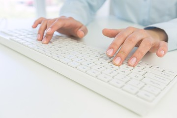 Network. Female office worker typing on the keyboard