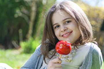 Beautiful  girl with caramel apple
