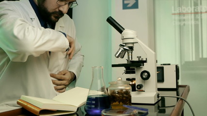 Male Scientist On Microscope