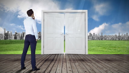 Door opening to city watched by businessman
