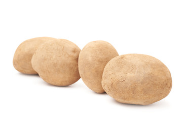 Four brown potatoes lined up