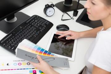 Studio. Graphic designer at work. Color swatch samples.