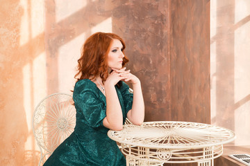 Woman siiting near window, vintage interior, luxury
