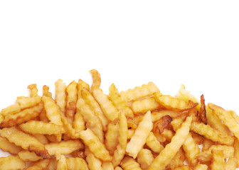 Pile of multiple wavy french fries isolated