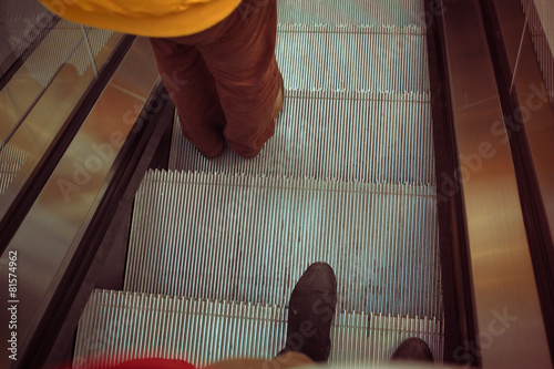 people going down the escalator - 81574962