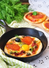 Pepperoni pizza and egg for breakfast