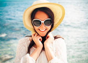 Happy woman in hat on the beach