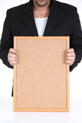 Businessman hold blank board