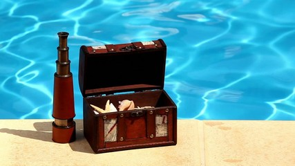 Concept background summer pool, trunk filled with shells