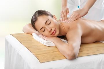 Spa. Beauty and spa concept - woman in spa salon getting massage © BillionPhotos.com