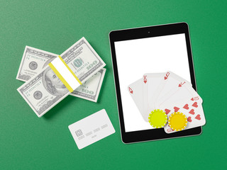 Cards and chips for poker on tablet.