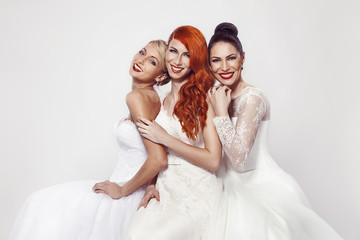 portrait of a three beautiful woman in wedding dress
