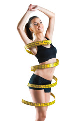 Fit young woman with a large measuring tape around her body