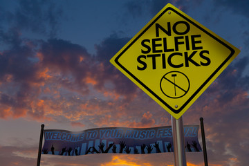 No selfie sticks sign at a music festival.