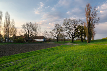 Spring landscape showing farm on countryside at dusk