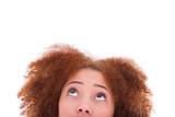 Young hispanic teenage girl looking up isolated on white backgro