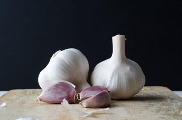 Garlic Bulbs and Cloves on Chopping Board