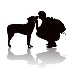 Silhouette of the young man with a dog