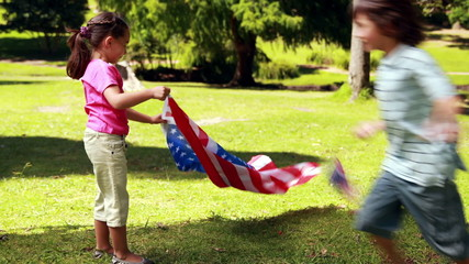 Little siblings with american flag