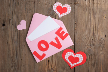 Love letter on old wooden background