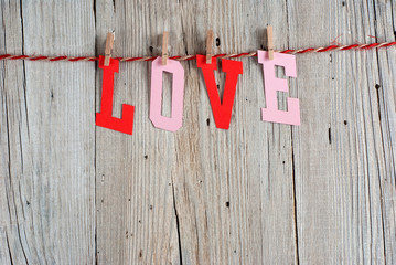 Word LOVE on old wooden background