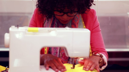 Fashion designer using sewing machine
