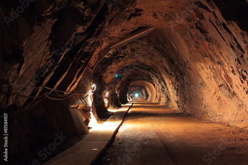 Dark tunnel in old uranium mine in Poland - 81584107